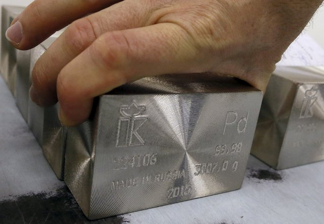 An employee places marked ingots of 99.98 percent pure palladium at the Krastsvetmet Krasnoyarsk non-ferrous metals plant in the Siberian city of Krasnoyarsk, Russia, June 5, 2015. Krastsvetmet is one of the world's largest players in the precious metals industry. REUTERS/Ilya Naymushin