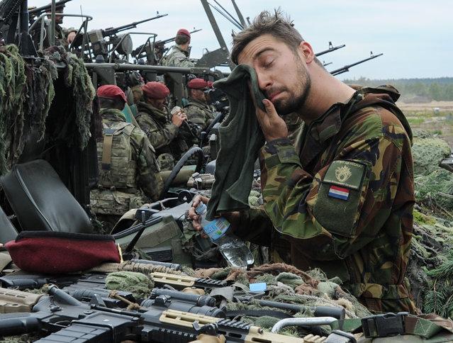 A Royal Dutch Army soldier wipes his face after the NATO Noble Jump exercise on a training range near Swietoszow Zagan, Poland, Thursday, June 18, 2015. (AP Photo/Alik Keplicz)