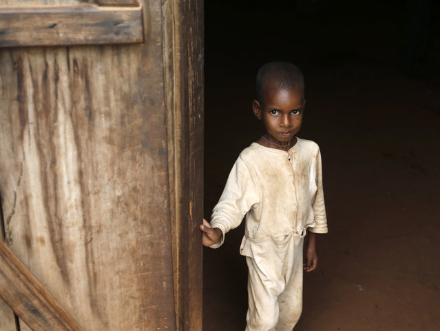 An internally displaced Muslim boy looks out of a house in the town of Boda April 15, 2014. (Photo by Goran Tomasevic/Reuters)