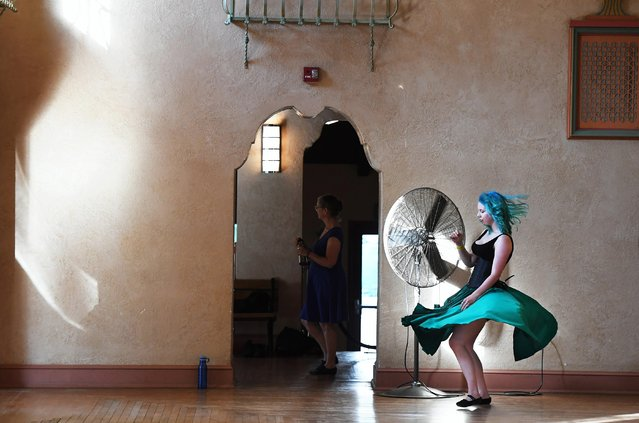 Jennie Harlow, 26, dances near a fan during a waltz dance event in the Spanish Ballroom at Glen Echo Park in Glen Echo, Md. on August 7, 2019. The building was built before air conditioning so dancers are cooled off by several fans positioned around the dance floor. (Photo by Matt McClain/The Washington Post)