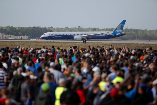 Employees and guest watch during the first flight ceremony of the new Boeing 787-10 Dreamliner at the Charleston International Airport in North Charleston, South Carolina, United States March 31, 2017. (Photo by Randall Hill/Reuters)