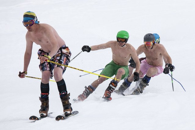 Skiers compete in the Bikini & Board Shorts Downhill at Crystal Mountain, a ski resort near Enumclaw, Washington April 19, 2014. Skiers and snowboarders competed for a chance to win one of four season's passes. (Photo by David Ryder/Reuters)