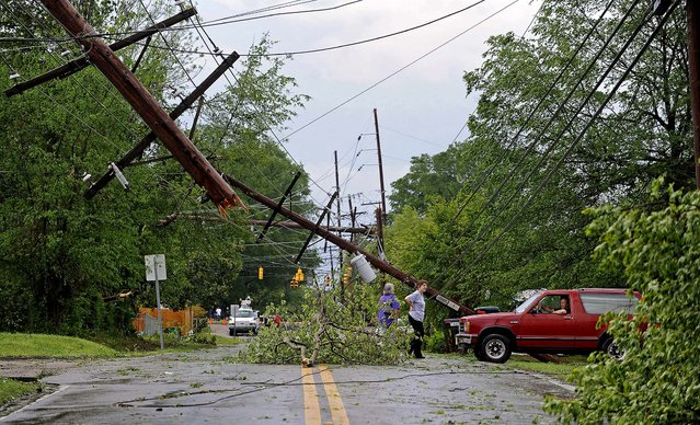 Residents survey damage along a street in Tupelo, Mississippi on Monday. (Photo by Thomas Graning/The Daily Mississippian)