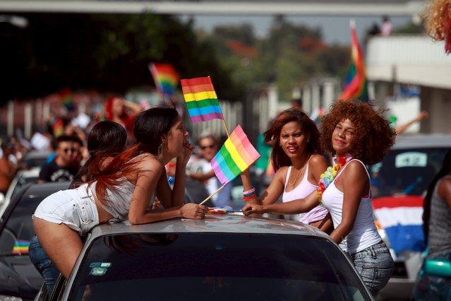 Women take part in a gay pride parade in Santo Domingo in the Dominican Republic July 5, 2015. (Photo by Ricardo Rojas/Reuters)