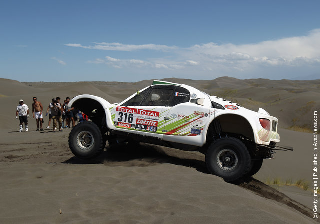 Ronan Chabot of France drives his SMG over a sand dune on stage two of the 2012 Dakar Rally