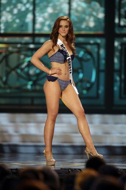 Miss North Dakota, Molly Ketterling, competes in the bathing suit competition during the preliminary round of the 2015 Miss USA Pageant in Baton Rouge, La., Wednesday, July 8, 2015. (Photo by Gerald Herbert/AP Photo)