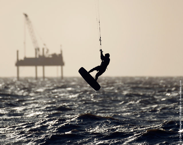 A kite surfer takes advantage of high winds and waves off Blackpool seafront