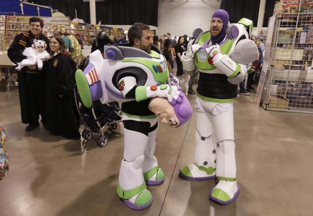 Kevin Feber, left, and Zach Pope as Buzz Lightyear talk on the floor of the Motor City Comic Con, Friday, May 13, 2016 in Novi, Mich. (Photo by Carlos Osorio/AP Photo)