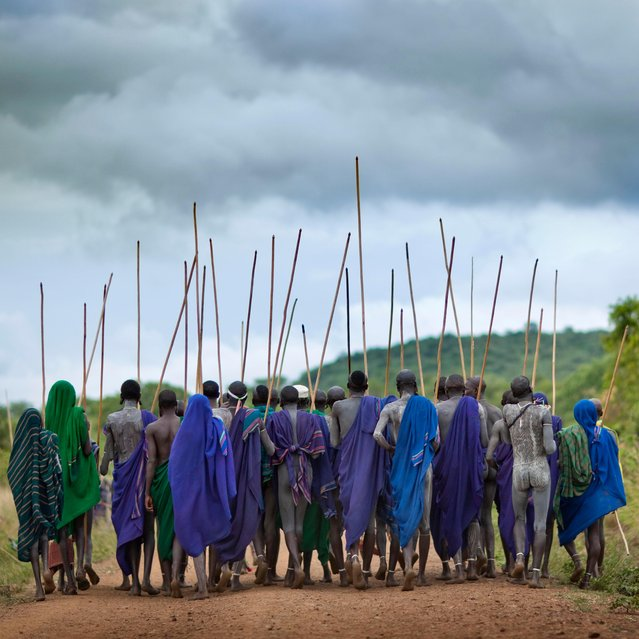 Warriors march in large groups singing and dancing on the way to the bloody battles, clutching their massive sticks. (Photo by Eric Lafforgue/Exclusivepix Media)