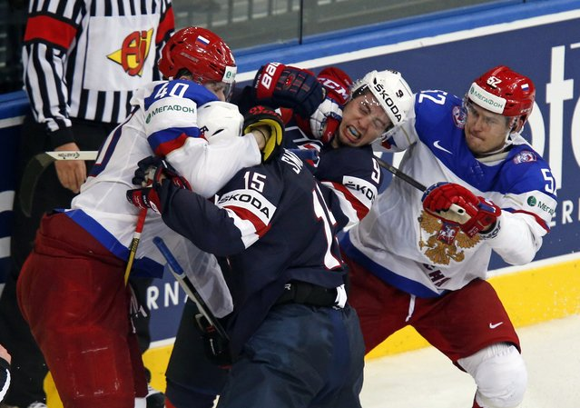 Russia's Sergei Kalinin (L) and Sergei Shirokov (R) scuffle with Craig Smith (15) and Tyler Johnson (9) of the U.S. during the second period of their men's ice hockey World Championship group B game at Minsk Arena in Minsk May 12, 2014. (Photo by Alexander Demianchuk/Reuters)