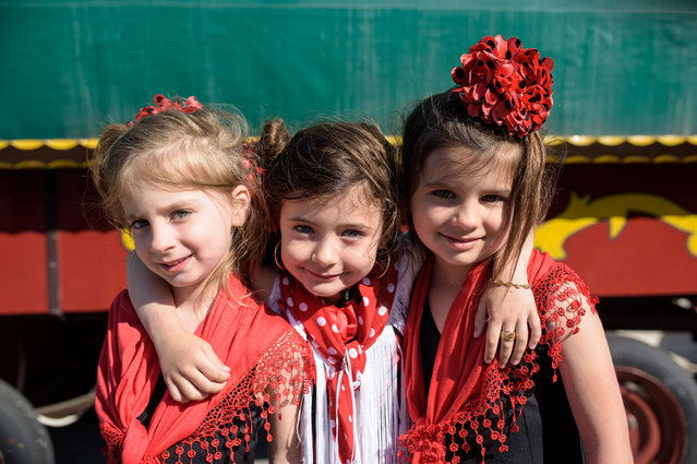 Young gypsy girls stand in front of a wagon on May 24, 2016 in Staintes Maries de la Mere near Arles, France. (Photo by Thomas Lohnes/Getty Images)