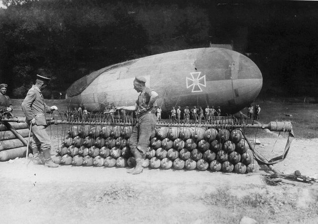 German soldiers attend to a stack of gas canisters attached to a manifold, inflating a captive balloon on the Western front. (Photo by National Archives/Official German Photograph via The Atlantic)