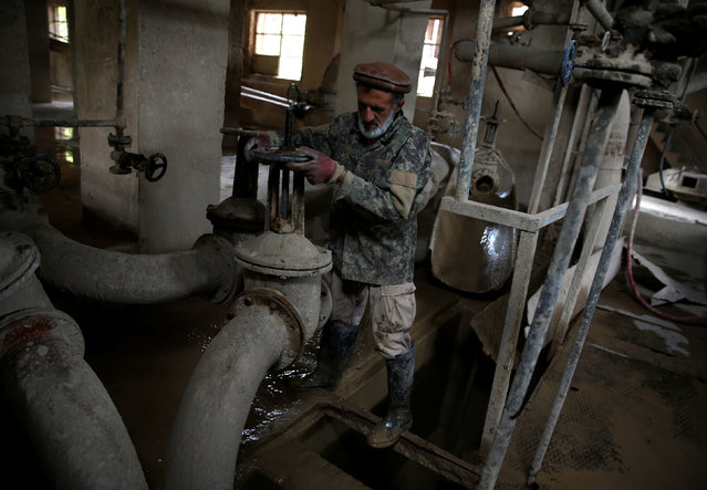 Dadullah, an employee at the Jabal Saraj cement factory, works at a plant in Jabal Saraj, north of Kabul, Afghanistan April 19, 2016. (Photo by Ahmad Masood/Reuters)