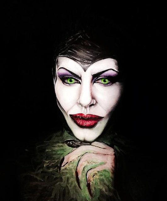 Angelina Jolie in Maleficent. 40-year-old London-based makeup artist, Maria Malone-Guerbaa has the ability to transform herself into any celebrity or creature using only her basic makeup essentials. Maria used only make up and face paints to create the illusion of Nelson Mandela, Britain's Queen Elizabeth II, and many other A-list celebrities. (Photo by Maria Malone-Guerbaa/Rex Features USA)