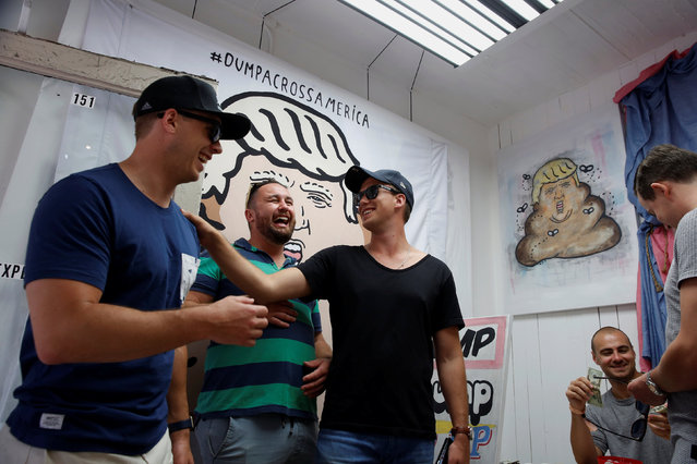 A group of men laugh at artwork referencing U.S. Republican presidential candidate Donald Trump made by the artist Hanksy and being sold at a temporary store in New York, U.S., June 4, 2016. (Photo by Lucas Jackson/Reuters)