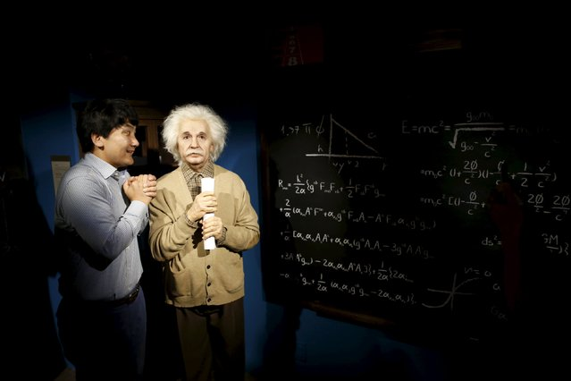 A man jokes next to the wax figure of Albert Einstein at Grevin Wax Museum in central Seoul, South Korea, July 30, 2015. (Photo by Kim Hong-Ji/Reuters)