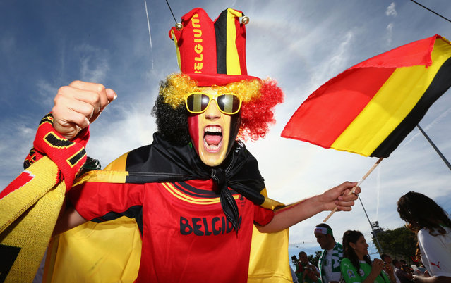 A face painted Belgium fan enjoys the atmosphere prior to the 2014 FIFA World Cup Brazil Group H match between Belgium and Algeria at Estadio Mineirao on June 17, 2014 in Belo Horizonte, Brazil. (Photo by Quinn Rooney/Getty Images)