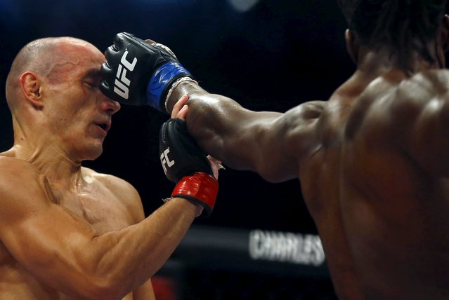 Vitor Miranda (L) of Brazil fights with Clint Hester of U.S during the Ultimate Fighting Championship (UFC), a professional mixed martial arts (MMA) competition in Rio de Janeiro, Brazil August 1, 2015. (Photo by Ricardo Moraes/Reuters)
