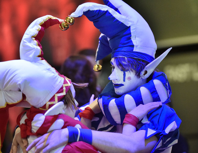 Costumed  participants hug each other  at the gamescom computer game   fair in Cologne, Germany, Wednesday, August 5, 2015. Hundreds of thousands of  visitors  will  enjoy one of the world's largest computer and video game events  until Sunday. (Photo by Martin Meissner/AP Photo)