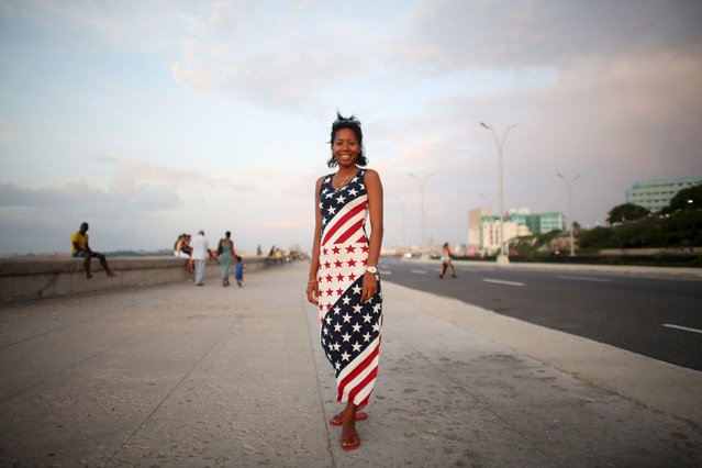 Psychologist Aliuska Garcia, 26, poses for a photo at the seafront Malecon in Havana, July 18, 2015. (Photo by Alexandre Meneghini/Reuters)