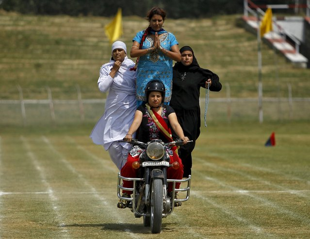 Indian policewomen, representing different religions, perform a stunt on a motorbike during the full-dress rehearsal for India's Independence Day celebrations in Srinagar, August 13, 2015. (Photo by Danish Ismail/Reuters)