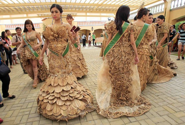 Candidates of the Miss Las Pinas Water Lily beauty pageant pose with their gowns made from dried water lilies during a media presentation in Las Pinas city, south of Manila July 24, 2014. According to the event organiser, the contest is part of events to celebrate the city's annual Water Lily festival. Local residents make gowns, bags and ornaments from parts of the aquatic plant as a source of livelihood. (Photo by Romeo Ranoco/Reuters)