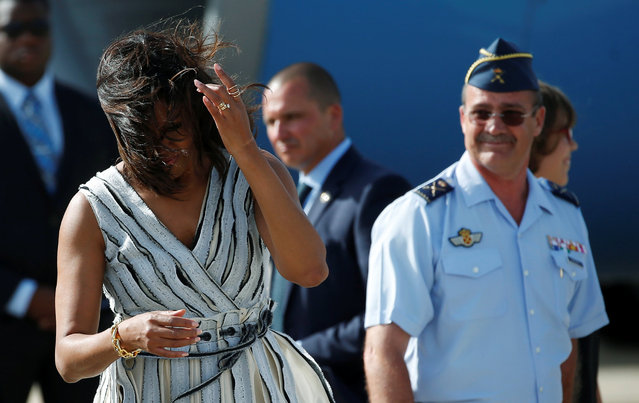 U.S. first lady Michelle Obama tries to keep her hair from her face upon arriving at the Torrejon airbase outside Madrid, Spain, June 29, 2016. (Photo by Susana Vera/Reuters)