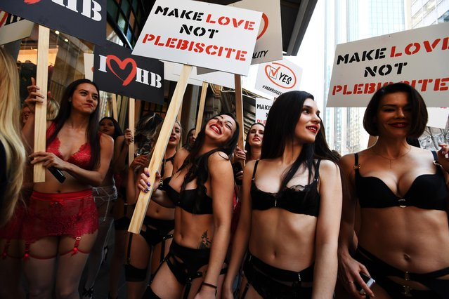 Models in lingerie are seen walking the streets of Sydney during a marketing campaign in support of marriage equality in Sydney, Australia on August 14, 2017. On Monday, 60 Honey Birdette employees took to the streets of the Sydney CBD in support for marriage equality ahead of the federal government's controversial postal plebiscite on the topic, with forms slated to arrive in Australians' mailboxes on September 12. (Photo by PA Wire)