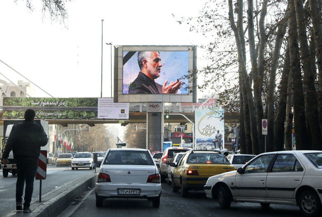 Portrait of Iranian Revolutionary Guard Gen. Qassem Soleimani, who was killed in Iraq in a U.S. drone attack on Friday, is shown on a screen in northern Tehran, Iran, Thursday, January 9, 2020. (Photo by Vahid Salemi/AP Photo)