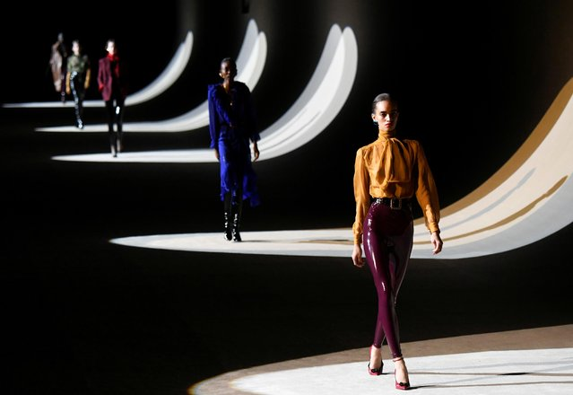 Models present creations by designer Anthony Vaccarello as part of his Fall/Winter 2020/21 women's ready-to-wear collection show for fashion house Saint Laurent during Paris Fashion Week in Paris, France, February 25, 2020. (Photo by Piroschka van de Wouw/Reuters)