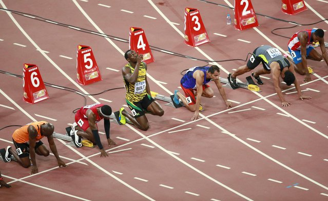 Usain Bolt of Jamaica (3rd L) gestures before his men's 100 metres heat at the 15th IAAF World Championships at the National Stadium in Beijing, China August 22, 2015. (Photo by Kim Kyung-Hoon/Reuters)