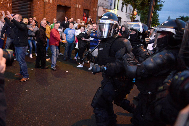 Nationalists in the Ardoyne area are seen clashing with police after the annual Twelfth of July Orange Order Parade in Belfast, Northern Ireland, July 12, 2016. (Photo by Clodagh Kilcoyne/Reuters)