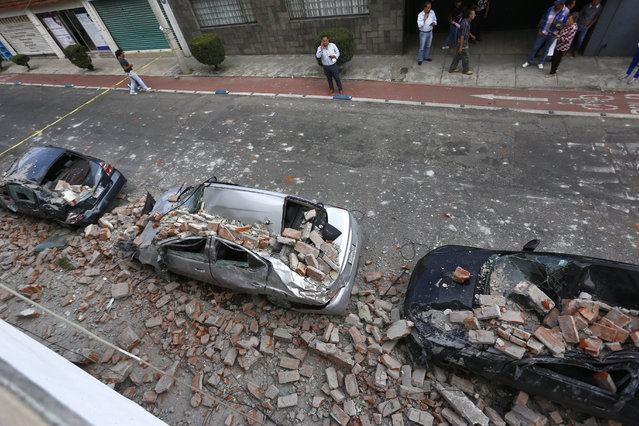 View of the damage after a magnitude 7 earthquake on the Richter scale, that affected Puebla, Mexico, 19 September 2017. At least 119 people died in the states of Morelos and Mexico after the magnitude 7 earthquake that shook the center of the country. (Photo by Francisco Guasco/EPA/EFE)