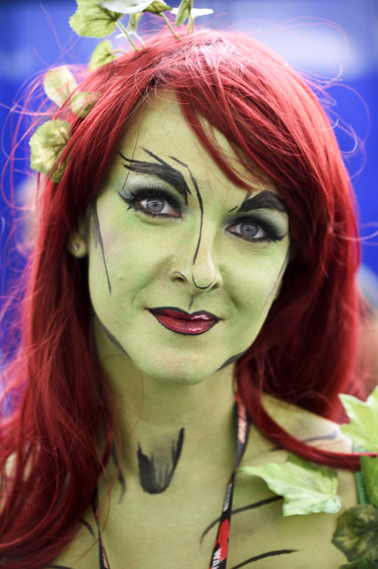 Sheila Noseworthy, dressed as Poison Ivy, poses for photographers on day three of the Comic-Con International held at the San Diego Convention Center Saturday July 23, 2016 in San Diego.  (Photo by Denis Poroy/Invision/AP Photo)