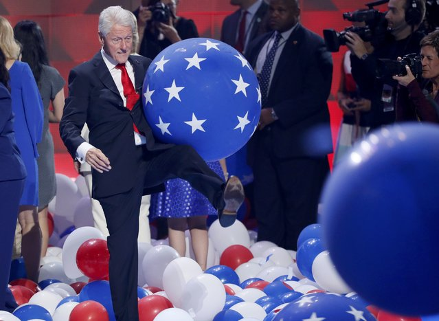 Former U.S. President Bill Clinton kicks ballons during celebrations onstage after his wife Democratic presidential nominee Hillary Clinton accepted the nomination on the fourth and final night at the Democratic National Convention in Philadelphia, Pennsylvania, U.S. July 28, 2016. (Photo by Mike Segar /Reuters)