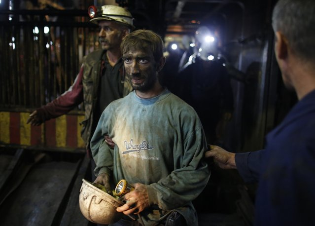 Trapped coal miners leave after they were rescued at the Raspotocje coal mine in Zenica September 5, 2014. Five Bosnian miners were confirmed dead on Friday, a day after an earthquake triggered a collapse at the mine, as emergency teams helped 29 others to the surface. (Photo by Dado Ruvic/Reuters)
