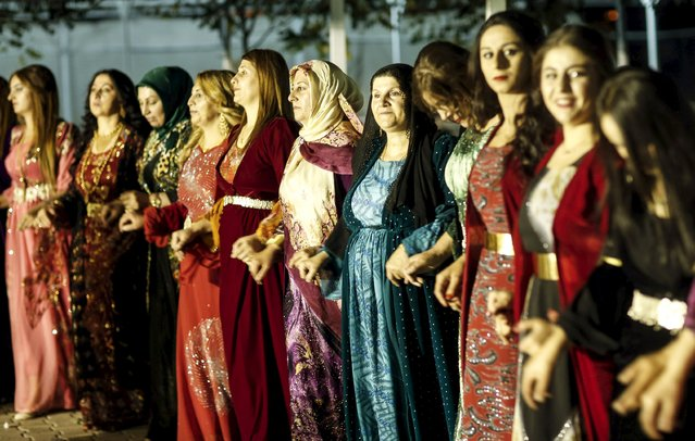 Turkish Kurdish women in traditional dresses dance during a pre-wedding henna ceremony in Yuksekova in the Kurdish-dominated southeastern Hakkari province of Turkey, September 5, 2015. (Photo by Huseyin Aldemir/Reuters)