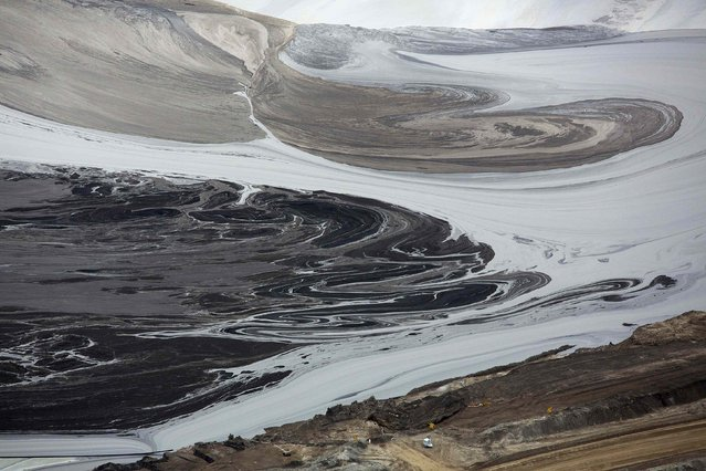 A tailings pond near the Syncrude tar sands operations near Fort McMurray, Alberta, September 17, 2014. Syncrude currently produces 350,000 barrels per day of high quality light, low sulphur crude oil according to company reports. (Photo by Todd Korol/Reuters)