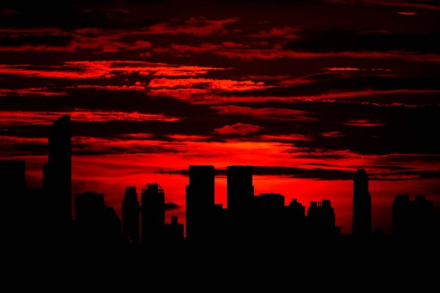 Sunset over Manhattan is seen from the USTA Billie Jean King National Tennis Center in Queens, on September 1, 2014. (Photo by Julian Finney/Getty Images)