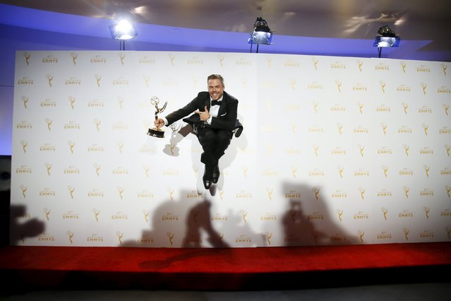 "Derek Hough poses with his outstanding choreography award for ""Dancing with the Stars"" that he won along with Julianne Hough and Tessandra Chavez, backstage at the 2015 Creative Arts Emmy Awards in Los Angeles, California September 12, 2015. (Photo by Danny Moloshok/Reuters)"