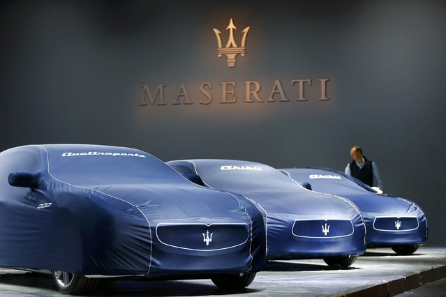 Veiled Maseratis are pictured during the media day at the Frankfurt Motor Show (IAA) in Frankfurt, Germany, September 14, 2015. (Photo by Kai Pfaffenbach/Reuters)