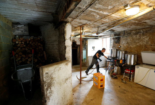 Axel Henrard, psychologist and President of the Belgian Homebrewers association, starts making his own beer in a former barn of his house in Attert, Belgium, August 11, 2016. (Photo by Francois Lenoir/Reuters)