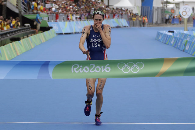 Gwen Jorgensen of the United States wins the women's triathlon competition of the 2016 Summer Olympics in Rio de Janeiro, Brazil, Saturday, August 20, 2016. (Photo by Gregory Bull/AP Photo)