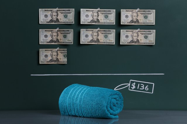 A locally produced bath towel as photographed in a studio with an illustrative price tag of $136 (US dollars), equivalent to the Bs. 859 (bolivars) that it costs on average to purchase in Caracas at the official exchange rate of 6.3 bolivars per dollar, in Caracas September 29, 2014. (Photo by Carlos Garcia Rawlins/Reuters)