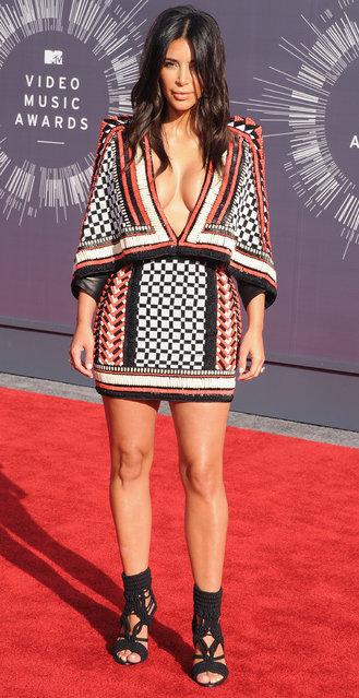 Kim Kardashian arrives at the 2014 MTV Video Music Awards at The Forum on August 24, 2014 in Inglewood, California. (Photo by Jon Kopaloff/FilmMagic)