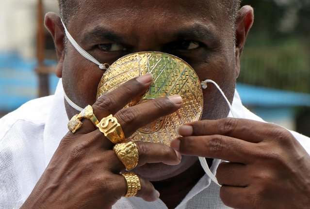 Shankar Kurhade (48), wears his face mask made out of gold as he poses for a photograph amidst the spread of the coronavirus disease (COVID-19) in Pune, India, July 4, 2020. Kurhade claims the mask weighs 50 grams and costs around $3870. (Photo by Reuters/Stringer)