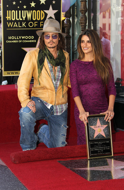 Actor Johnny Depp (L) and actress Penelope Cruz pose for photographers during the installation ceremony for her star on the Hollywood Walk of Fame on April 1, 2011 in Hollywood, California. (Photo by Frederick M. Brown/Getty Images)