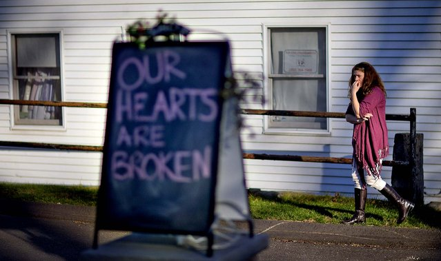 Shop owner Tamara Doherty, paces outside her store just down the road from Sandy Hook Elementary School on Saturday. (Photo by David Goldman/Asaociated Pess)