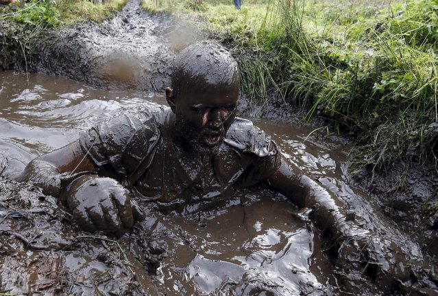 A man takes part in an extreme run competition in Zhodino, east of Minsk, September 26, 2015. (Photo by Vasily Fedosenko/Reuters)