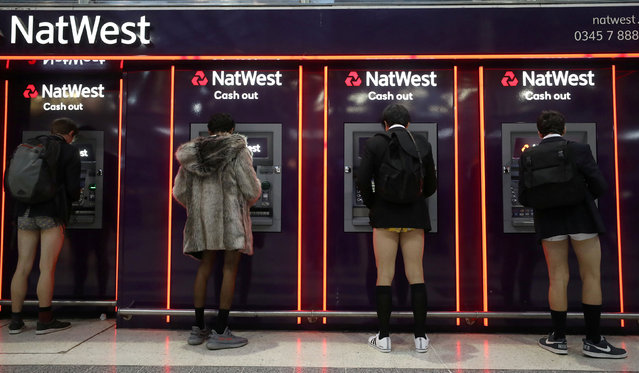 """Passengers without trousers stand at cash machines as part of the """"No Trousers on the Tube Day"""" event, in London, Britain January 7, 2018. (Photo by Simon Dawson/Reuters)"""
